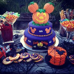 Mickey mouse halloween birthday party cake-do bottom purple layer and then the spider web layer on the top rather then the big pumpkin mickey