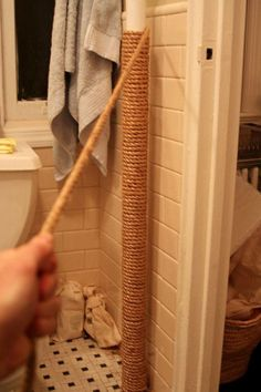 """When I first saw this I thought """"Oh, that's a neat idea!"""". Max from Apartment Therapy used manila rope to wrap a hot pipe in his bathroom to prevent burns and add some insulation as well. For a little more colour, another choice would be to use double braid nylon. A really simple idea that adds a unique touch to the bathroom."""