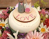 Custom Wooden Bride and Groom Wedding Couple for Gift or Cake Topper. £25,00, via Etsy.