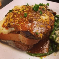 Open faced meatloaf sandwich with mashed potatoes and asparagus