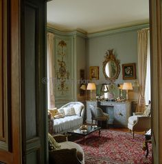 "House of Windsor, Paris - In the Duchess of Windsor's bedroom the red tones of an elaborate Persian rug create a pleasing contrast to pale blue upholstery and walls painted a subtle turquoise, her favourite colour and known as ""Wallis Blue"" Decor, Interior Design, House Interior, House, Interior, Blue Bedroom, Home Decor, Living Design, Room"