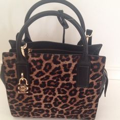 Michael Kors cheetah Satchel. No TRades Michael Kors cheetah Satchel. Front  cheetah pattern of Satchel is made with soft  dyed calf hair.  Satchel is 14 inches wide and 10 inches in height. Satchel come with detachable clip purse strap and can be carried with strap or by its  two handles.⚠no tradesplease don't ask what's lowest price make an offer using the make a offer button. Prices will not be negotiated in the comment section. Happy Poshing Michael Kors Bags Satchels