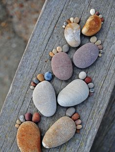 """The series """"Stone Footprints"""" by photographer Iain Blake, simple and cute land art made with round pebbles found on the beach. A series of childish and naive photographs that make you smile … - Pebble Painting, Pebble Art, Stone Painting, Pebble Stone, Pebble Mosaic, Creative Crafts, Diy And Crafts, Crafts For Kids, Arts And Crafts"""