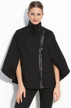 A cape that doesn't make you look like Dracula or the Phantom of the Opera.  This is modern-looking & the off center zipper is unexpected.  $138.