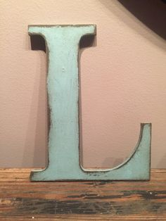 Rustic Letters have a distressed look and are made to order. Each letter is approximately 9.5 high and 7.5 across with a width of .25. Sizes vary depending on each individual letter.  Perfect to use as a cake topper, letters for a nursery, or as custom wall art. Due to the distressed look, each let