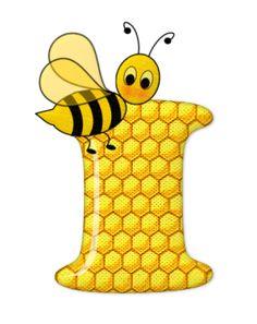 Alfabeto de abeja sobre letras de panal.
