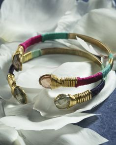 "This beauty brings new meaning to the phrase ""arm party!"" Stack these bright bangles high for some exotic charm."