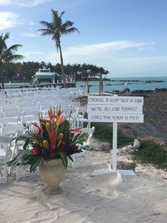 The Jetty setup with 140 chairs for a beautiful Wedding Ceremony! #Ceremony #Wedding #Setup #Flowers #Starfish #Sign #TheJetty #Yachts #Boats #Resort #WeddingArch #Pelicans #Sand
