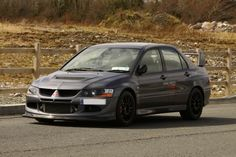 Mitsubishi Lancer Evo Viii 2.0 MR FQ-400 AWD. Sold through Ralliart UK, produces 411 PS (302 kW; 405 hp) from its 2.0 L 4G63 engine, 0–60 mph in 3.5 seconds