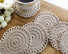 Items similar to Cotton Lace Doily, Round cup mat , Home Wedding Decor, Handmade Table Decoration, Crochet round coasters on Etsy Crochet Earrings Pattern, Crochet Coaster Pattern, Crochet Motif, Hand Crochet, Crochet Stitches, Crochet Round, Crochet Home, Crochet Gifts, Doilies Crochet