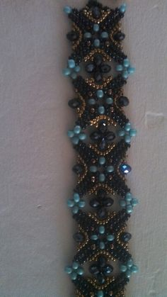 Bracelet: Anyone know who the designer is? This is lovely!