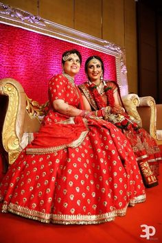55c56745bdf Mother of the Bride - Mother if the Bride in a Red Elegan Lehenga with  Small Gold Booties