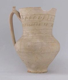Jug  Date: late 9th–early 10th century Geography: Iran, Nishapur Medium: Earthenware; covered with slip, incised and unglazed