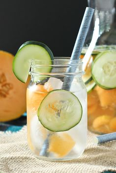 Cantaloupe and cucumber water is not only ridiculously refreshing on a hot summer day, it's also beautiful to look at! Get the easy recipe on RachelCooks.com!
