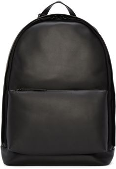 Structured buffed leather backpack in black. Detachable carry handle at top. Adjustable shoulder straps. Zippered compartment at face. Crisscrossing straps at back…