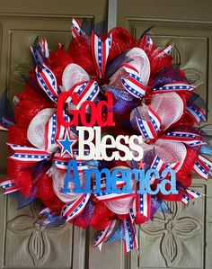 "This is a 24"" deco mesh patriotic wreath made of red, white and blue mesh with patriotic ribbons and accented with a hand painted wooden God Bless America sign. ALL custom wreaths and hand painted gla"