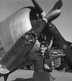 19-year-old Lieutenant Edwin Wright looks upon his airplane after being hit by an 88 mm shell over the city of Munster Germany.