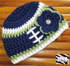 Seattle Seahawks Football Beanie with Flower by LittleMimiLulu, $14.99 This will be going on my child in the future. Hands. Down. Go seahawks!