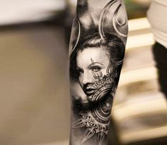 Woman face tattoo by Oscar Akermo