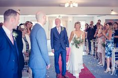 Bride escorted down the aisle by father at Italian Villa Wedding Photographs. Photography by one thousand words wedding photographers