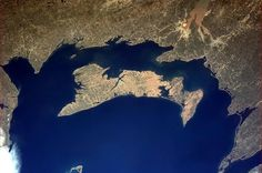 """Prince Edward Island from the ISS (International Space Station)--posted on April 2013 by Col. Chris Hadfield in the ISS. He said: """"The red soil that makes Prince Edward Island's potatoes so famous is visible from space. Chris Hadfield, Hidden Photos, Earth Photos, Aerial Images, Prince Edward Island, Anne Of Green Gables, Sea And Ocean, Free Things To Do, Canada Travel"""