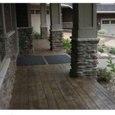 Stamped concrete that looks like hardwood flooring (so cool) and I love the pillars with the stone. All outdoor patio and porch for the new house. I love this but It has to be real hardwood. Not stamped concrete Concrete Patios, Concrete Front Porch, Concrete Floors, Porch Wood, Wood Patio, Wood Decks, Stained Concrete Driveway, Wood Walkway, Outdoor Walkway