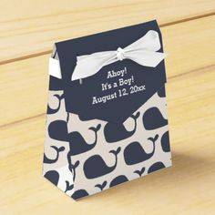 "Whale Theme Baby Shower Favor Boxes This cute tent style boxes have a whale pattern in a nautical navy blue color. The flap is a coordinating blue and the text reads ""Ahoy! It's a Boy! August 12, 20xx"". Personalize these fun boxes with the baby's information. These are great for baby shower parties as well as announcing the new arrival. They also work well for a boy's birthday party with a whale theme. #whale #whales #nautical #blue #baby #shower #party #ahoy #it's #a #boy #announcement…"