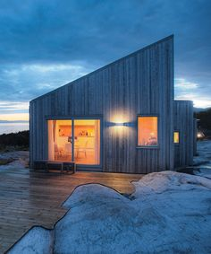 TYIN tegnestue architects embeds timber cottage into the rugged terrain in norway