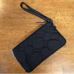 ThirtyOne Vary you wristlet black quilted dots NIP NIP Black Quilted Dots Vary You Wristlet. First 3 pics are stock to show what it looks like last is actual item. Hole in packaging from storage but item is in perfect condition. Thirtyone Bags Clutches & Wristlets