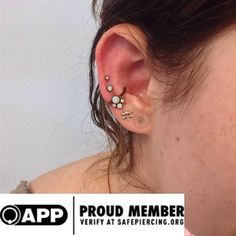 Last week Aaron got to do this fun ear project. Featured is a white opal cluster and niobium CBR from Anatometal. 2x 18g Helix piercings wit...