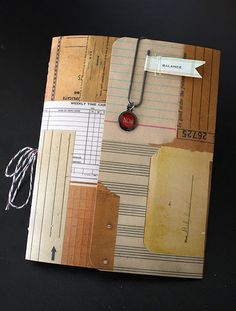 Really pretty DIY journal or notebook with string-tied pages. Tutorial here. She used clear caulk to water proof the outside cover.