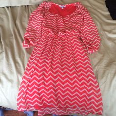 Pink Chevron Dress Super cute dress that goes a little above your knee with half sleeves.  Has an elastic waist. Worn to try on. Practically brand new. Macy's Dresses Midi