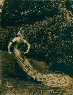 """Ruth St. Denis (January 20, 1879 – July 21, 1968) was a modern dance pioneer, introducing eastern ideas into the art. She was co-founder of the American Denishawn School of Dance and the teacher of several notable performers. This costume is for """"The Peacock"""""""