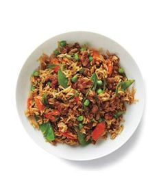 Transform ground turkey into a family-pleasing meal with white rice, snow peas, carrots, garlic, and ginger.