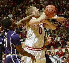 Chris Howell | Herald-TimesIndiana Hoosiers forward Max Bielfeldt (0) is fouled by Northwestern Wildcats guard Jordan Ash (23) during the Indiana Northwestern men's college basketball game at Assembly Hall in Bloomington, Ind. January 23, 2016.