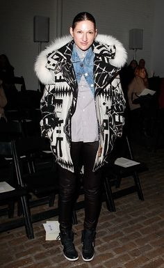 Jenna Lyons attended Yigal Azrouël's show looking extremely cozy in a black and white coat with a furry hood, which she layered over a denim jacket, a striped blouse, leather pants, and high-top sneakers.