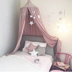 Lovely pink layout with N74 dusty pink canopy, star cushions and falling star garland