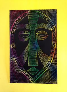 *Staple scratch art to larger construction paper to avoid finger prints - African mask