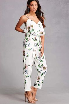 A pair of woven pants featuring an allover floral print, a high-waist fit, self-tie shirred waist, a zip front closure, and slanted front pockets.<p>- Matching top available.</p>