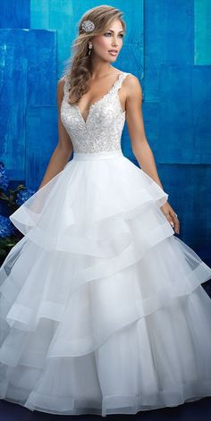 Tiered structured ruffles compose the full skirt of this beaded ballgown.