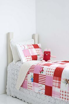 My goal is to make each of my kids at least two quilts: one baby quilt and an adorable one like this for their bed. <3