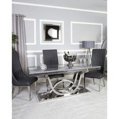 Pluto Grey Marble Dining Table Exude style and sophistication in your dining room with this sleek dining table set Featuring an interlocking curve design chrome base with a marble, Gray Dining Chairs, Chrome Dining Set, Luxury Dining Room, Marble Tables Living Room, Dining Furniture, Dining Table, Dining Table Marble, Dining Table Chairs, Dining Table Design