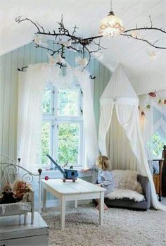 Magical reading nook... I want branches like this in my little space :)