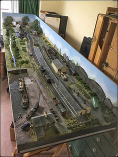A very nicely detailed modular model railroad. love the wharf scene.
