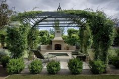 iron #pergola with a #fireplace and #fountain