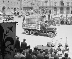 July 21, 1945 Six trucks carrying part of the half billion dollars worth of Florentine art treasure taken to Bolsano by retreating Germans arrive at Piazzo Dei Signoria, Florence, Italy