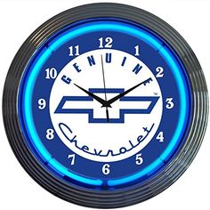 This Genuine Chevrolet Neon Clock sports the Chevy bowtie logo and looks awesome in a garage or man cave. Blue and white clock has a chrome-dipped plastic housing and glass neon tube. Takes 1 AA battery and includes A/C adapter. 15 in. Wall Clock Glass, Wall Clocks, Starbucks, Neon Clock, Chevy Chevrolet, Gm Chevy, Chevy Silverado, Man Cave Home Bar, Man Cave Garage