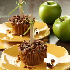 Caramel Apple Cupcakes Recipe -Bring these extra-special cupcakes to your next bake sale and watch how quickly they disappear—if your family doesn't gobble them up first! Kids will go for the fun appearance and tasty toppings while adults will appreciate the moist spiced cake underneath.