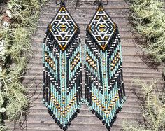 Beaded fringe earrings >Eagle Call< in a geometric Native American motif. Hypo-allergenic surgical steel earring hooks. Majestic beauties..    Dimensions:  Width: 1.5inches  Length (including earwires)- 4inches (10cm)    >>>>>>>> Welcome to Hoof&Arrow <<<<<<<<<    Handmade with love, laughter, and good vibes.    My work is inspired by vintage moods, the art of the native cultures, mountain magic, desert moons, vagrant winds and appreciation and celebration of the natural beauty.    Made…