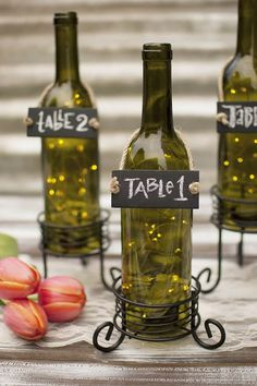 fairy lights inside bottles for table numbers
